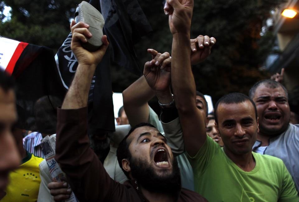 Egyptian protesters chant anti-U.S. slogans during a demonstration in front of the U.S. embassy in Cairo, Egypt, Wednesday, Sept. 12, 2012 as part of widespread anger across the Muslim world about a film ridiculing Islam's Prophet Muhammad.(AP Photo/Nasser Nasser)