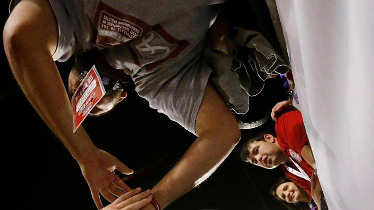 Alabama's AJ McCarron celebrates with fans after the BCS National Championship college football game against Notre Dame Monday, Jan. 7, 2013, in Miami. Alabama won 42-14. (AP Photo/John Bazemore)