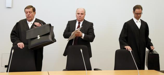 Bayern Munich President Hoeness stands with his lawyers before start of his trial for tax evasion at regional court in Munich
