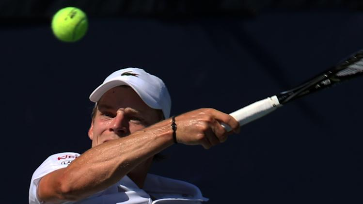 David Goffin, of Belgium, returns a shot against Joao Sousa, of Portugal, during the second round of the 2014 U.S. Open tennis tournament, Friday, Aug. 29, 2014, in New York. (AP Photo/John Minchillo)