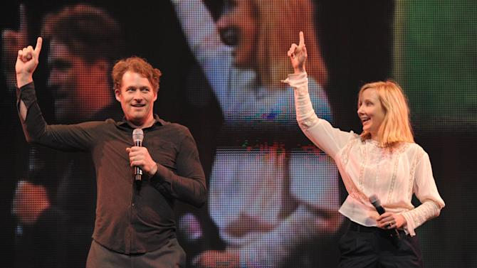 James Tupper, left, and Anne Heche perform onstage at Yo Gabba Gabba! Live!: Get The Sillies Out! 50+ city tour kick-off performance on Thanksgiving weekend at Nokia Theatre L.A. Live on Friday Nov. 23, 2012 in Los Angeles. (Photo by John Shearer/Invision for GabbaCaDabra, LLC./AP Images)