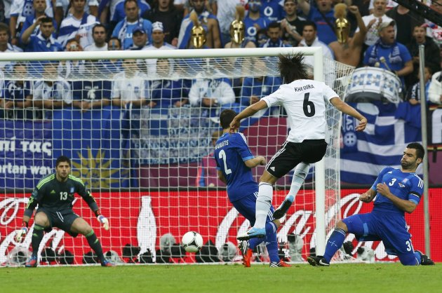 Germany's Khedira attacks Greece's Sifakis past Maniatis and Tzavellas during  their Euro 2012 quarter-final soccer match at the PGE Arena in Gdansk