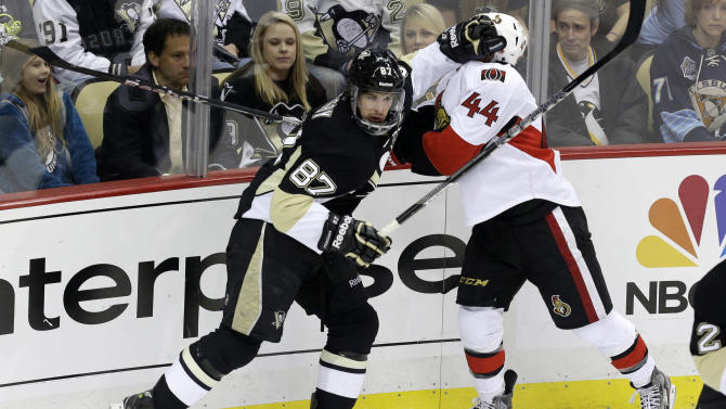 Pittsburgh Penguins' Sidney Crosby (87) collides with Ottawa Senators' Jean-Gabriel Pageau (44) in the third period of Game 1 of an NHL hockey Stanley Cup second-round playoff series in Pittsburgh Tuesday, May 14, 2013. The Penguins won 4-1. (AP Photo/Gene J. Puskar)