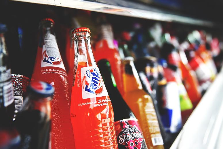 The Reason You're Reaching for Another Soda Isn't Just the Caffeine High