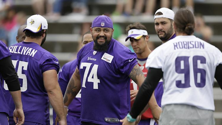 Minnesota Vikings guard Charlie Johnson (74) talks with defensive end Brian Robison (96) during NFL football training camp, Monday, July 28, 2014, in Mankato, Minn