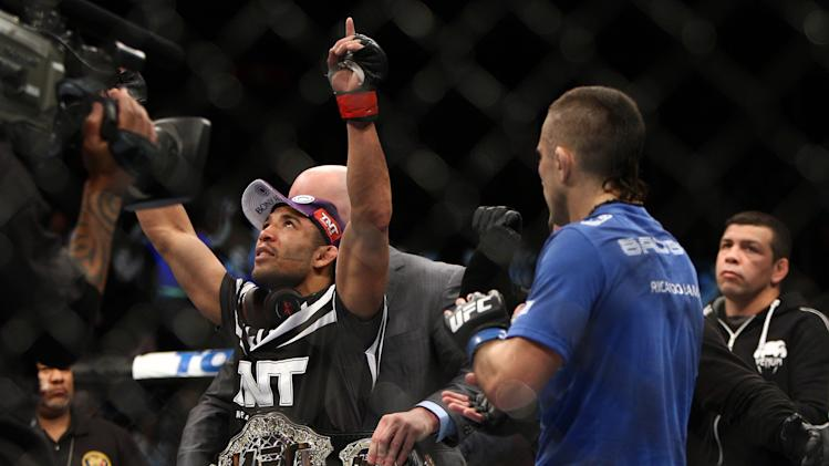 Jose Aldo, left of Brazil celebrates after beating Ricardo Lamas of Chicago, IL in five rounds of the Ultimate Fighting Featherweight Championship Mix Martial Arts bout in Newark, N.J. on Saturday, Feb. 1, 2014. Aldo won by unanimous decision in five rounds. (AP Photo/Tim Larsen)