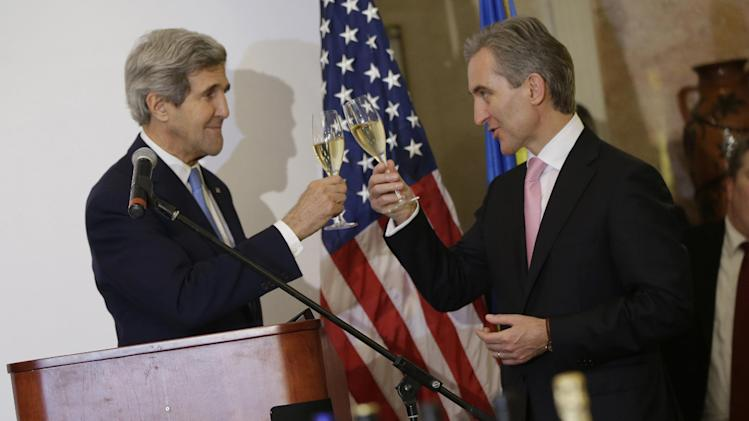 US Secretary of State Kerry toasts with Moldovan Prime Minister Leanca during a tour of the Cricova Winery in Chisinau