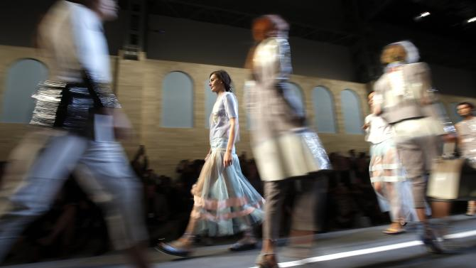 Models parade at the end of Fendi Spring/Summer 2015 collection during Milan Fashion Week