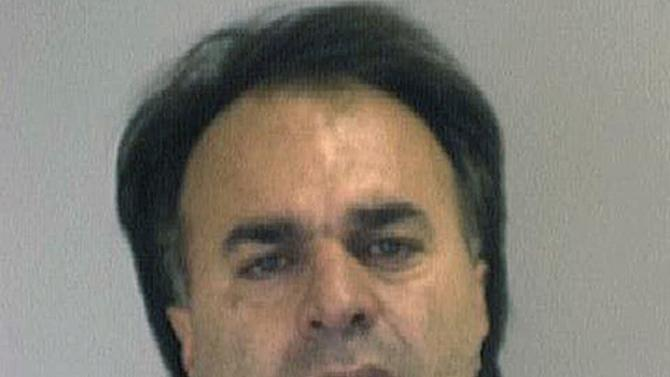 FILE - This undated file photo provided by the Nueces County Sheriff's Office shows Manssor Arbabsiar, a U.S. citizen with an Iranian passport who pleaded guilty in October 2012 to conspiracy and murder-for-hire in a plot to assassinate Saudi Arabia's ambassador to the United States. Arbabsiar told the court that Iranian military officials were involved in the planning. A new report warns that Iran's elite Quds Force and Hezbollah militants are learning from this and other botched terror attacks over the past two years and post a growing threat to the U.S., Israel and other Western targets. (AP Photo/Nueces County Sheriff's Office, File)