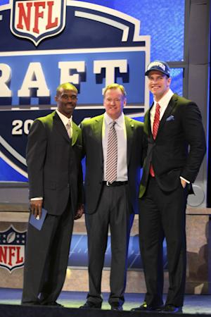 Stanford tight end Coby Fleener, right, poses for photographs with NFL Commissioner Roger Goodell, center, and Tory Holt, left, after being selected 34th overall by the Indianapolis Colts in the second round of the NFL football draft at Radio City Music Hall, Friday, April 27, 2012, in New York. (AP Photo/John Minchillo)