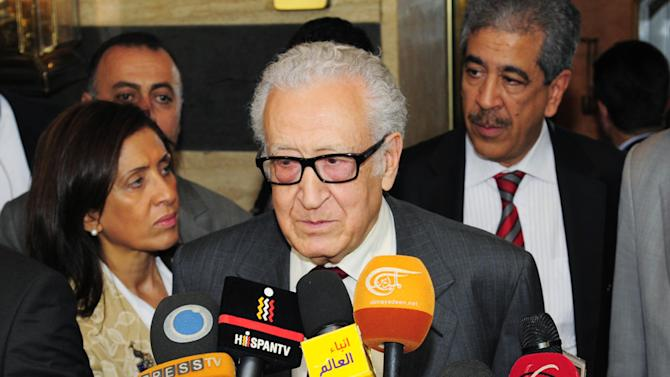 In this photo released by the Syrian official news agency SANA, U.N.-Arab League envoy for Syria, Lakhdar Brahimi, speaks to reporters in Damascus, Syria, Tuesday, Oct. 29, 2013. Brahimi has met a senior opposition figure in Damascus as part of a diplomatic push to convince all sides in the country's crisis to attend peace talks in Geneva next month. (AP Photo/SANA)