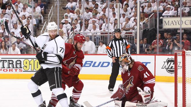 Jeff Carter #77 Of The Los Angeles Kings And Derek Morris #53 Of The Phoenix Coyotes Vie For Position In The Low Slot Getty Images