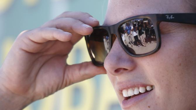 Cameramen are reflected in the sunglasses of Zara Phillips before the start of the Sydney to Hobart Yacht Race at the Cruising Yacht Club in Sydney
