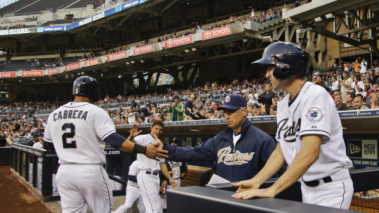 San Diego Padres manager Bud Black, right, congratulates Everth Cabrera after Cabrera scored against the St. Louis Cardinals in the first inning of a baseball game in San Diego, Monday, May 20, 2013. (AP Photo/Lenny Ignelzi)