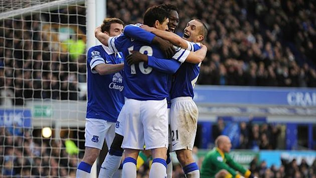 Everton's Gareth Barry celebrates scoring the opening goal of the game with his team-mates (PA Photos)