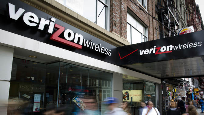 FILE - In this June 6, 2013, file photo, pedestrians pass a Verizon Wireless store on Canal Street in New York. Verizon reports quarterly earnings on Thursday, Oct. 17, 2013. (AP Photo/John Minchillo, File)