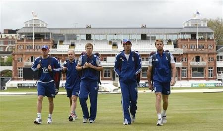 England's Jonny Bairstow (L), Jonathan Trott (2nd L), Joe Root (C), Alastair Cook and Nick Compton (R) walk to a training session before Thursday's first cricket test against New Zealand at Lord's cri