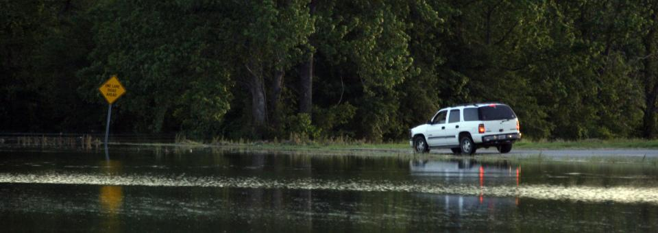 A driver tries to drive on a submerged portion of Mississippi Highway 465 on his way to Eagle Lake, near Vicksburg, Miss., before rising flood waters stopped him, Thursday, May 5, 2011. Residents along Mississippi River tributaries are evacuating ahead of the possible record flooding. (AP Photo/Rogelio V. Solis)