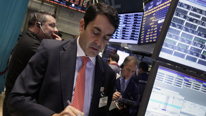 Trader Mark Muller, center, works on the floor of the New York Stock Exchange Wednesday, Oct. 3, 2012. Stocks are mostly higher in early trading on Wall Street Wednesday after a measure of private sector hiring came in better than economists were expecting. (AP Photo/Richard Drew)