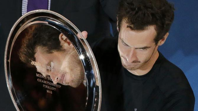 Murray of Britain is reflected in his runner-up trophy after losing to Djokovic of Serbia in their men's singles final match at the Australian Open 2015 tennis tournament in Melbourne