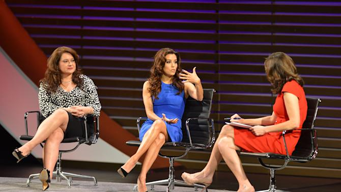 This image released by the Women in the World Conference shows Lorena Chambers, CEO, Chambers Lopez Strategies LLC, left,  actress, activist and philanthropist Eva Longoria, center, and moderator Campbell Brown during a panel discussion at the Women in the World Conference  on Friday, April 5, 2013 in New York.  (AP Photo/Women in the World, Marc Bryan-Brown)