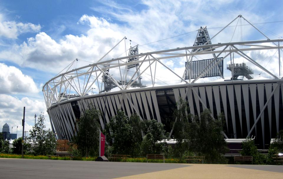 This Saturday June 30, 2012 photograph shows clouds above the Olympic stadium, London.  An AP journalist who spent hours in the Olympic Park trying to get her credentials validated accidentally stumbled upon a rehearsal by some 2,000 performers for London's opening ceremony.   (AP Photo/Sheila Norman-Culp)