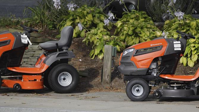 A pair of Husqvarna lawn tractors sit in front of a store in Plymouth, Mass., Tuesday, Sept. 27, 2011. A slump in demand for autos and primary metals pushed orders for long-lasting manufactured goods down in August following a big increase in July. The August setback underscored that the manufacturing sector has slowed in response to weak consumer demand. (AP Photo/Stephan Savoia)