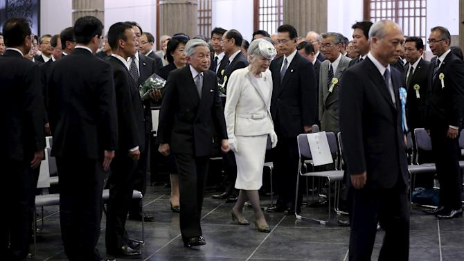 Yoichi Masuzoe, Governor of Tokyo escorts Japan's Emperor Akihito and Empress Michiko during a memorial service for  the victims of Great Kanto earthquake in 1923 and the Great Tokyo Air Raids in 1945, at Tokyo Memorial Hall in Tokyo