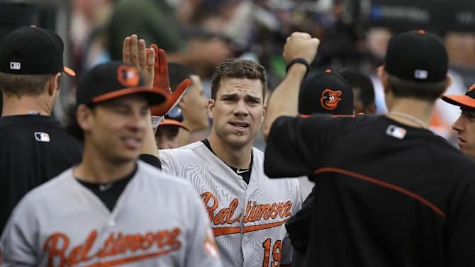Baltimore Orioles' Chris Davis, center, celebrates hitting a solo home run against the Detroit Tigers in the second inning of a baseball game in Detroit, Monday, June 17, 2013. (AP Photo/Paul Sancya)