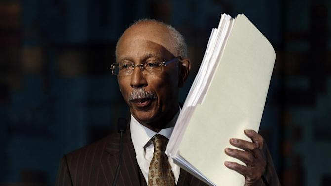 Detroit Mayor Dave Bing holds up signature sheets while speaking during a news conference in Detroit, Tuesday, May 14, 2013. Bing announced he won't seek a second term as leader of the financially troubled city, which recently became the largest in the country placed under state oversight.  (AP Photo/Paul Sancya)