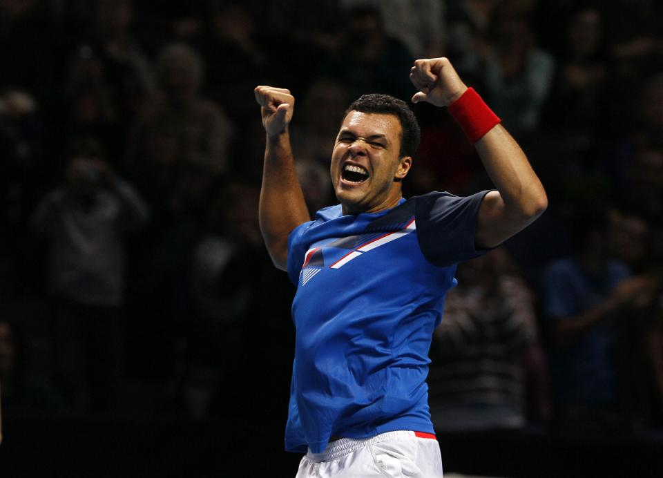Jo-Wilfried Tsonga of France celebrates after defeating Mardy Fish of the U.S. in their round robin singles tennis match at the ATP World Tour Finals, at the O2 arena in London, Tuesday, Nov. 22, 2011.(AP Photo/Alastair Grant)