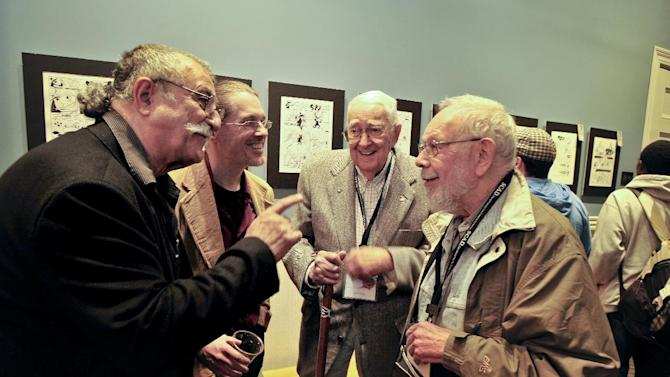 Mad Magazine cartoonist Sergio Aragones, left, Jack Davis and Al Jaffee, right, speak with Savannah College of Art and Design professor John Larison, second from the left, during an event hosted by SCAD and the National Cartoonists Society, Friday, Oct. 11, 2011 in Savannah, Ga.  Aragones, Jaffee and Davis are among eight veteran MAD contributors gathering Saturday for a rare reunion. (AP Photo/Stephen Morton)