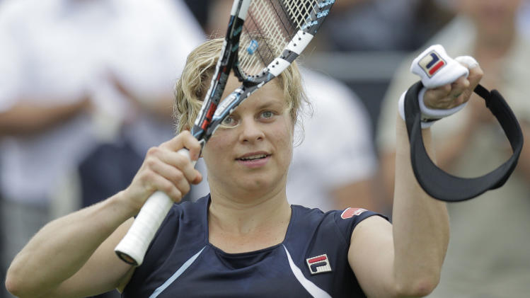 Kim Clijsters of Belgium celebrates winning her match against Francesca Schiavone of Italy at the Unicef Open grass court tennis tournament in Rosmalen, central Netherlands, Thursday, June 21, 2012. Clijsters won in two sets 6-3, 7-6. (AP Photo/Peter Dejong)