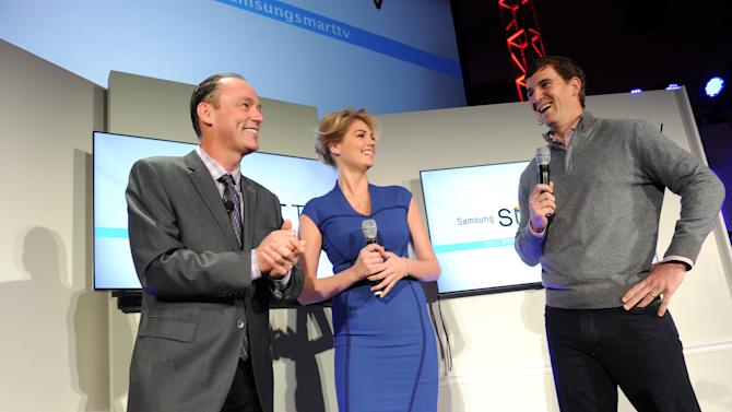 IMAGE DISTRIBUTED FOR SAMSUNG - Tim Baxter, left, President, Samsung Electronics America, model Kate Upton and football quarterback Eli Manning showcase the 2013 line of Smart TVs, Wednesday, March 20, 2013, in New York. Samsung?s new line allows the viewer to discover more of the TV they love with a smarter and more personalized experience.  (Photo by Diane Bondareff/Invision for Samsung/AP Images)