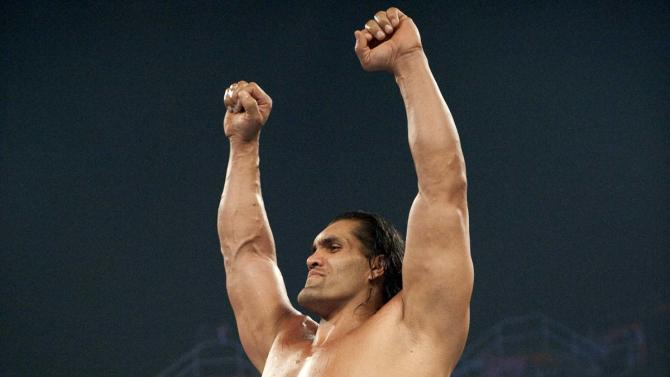This 2009  image released by World Wrestling Entertainment shows World Wrestling Entertainment star The Great Khali. On Wednesday, July 25, 2012, doctors at UPMC Presbyterian in Pittsburgh removed a pituitary gland tumor that's the cause of his formidable size. Hospital spokeswoman Susan Manko says The Great Khali, whose real name is Dalip Singh, is recovering well and is expected to be released over the weekend.  (AP Photo/© 2012 WWE)