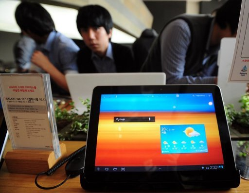 "<p>The Galaxy Tab is displayed at the KT Mobile showroom in Seoul, South Korea, in 2011. South Korea's Samsung won a patent battle Monday against US rival Apple, with a British judge ruling that Samsung's Galaxy tablet was not ""cool"" enough to be confused with Apple's iPad.</p>"