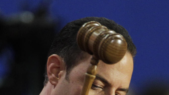 Chairman of the Republican National Committee Reince Priebus gavels open the abbreviated first session of Republican National Convention in Tampa, Fla., on Monday, Aug. 27, 2012. (AP Photo/Charlie Neibergall)