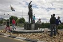 Visitors walk past a statue of Nelson Mandela outside the Victor Verster Prison near Paarl