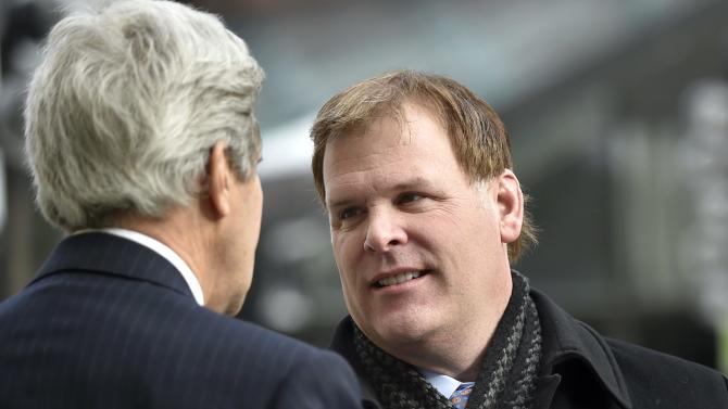 Canadian Foreign Minister John Baird greets U.S. Secretary of State John Kerry at Faneuil Hall in Boston
