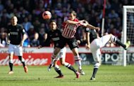 Sheffield United's Michael Doyle (centre) in action with Charlton Athletic's Jordan Cousins (right) and Diego Poyet