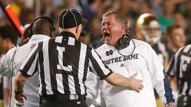 Notre Dame head coach Brian Kelly argues a call during the first half of the BCS National Championship college football game against Alabama Monday, Jan. 7, 2013, in Miami. (AP Photo/John Bazemore)