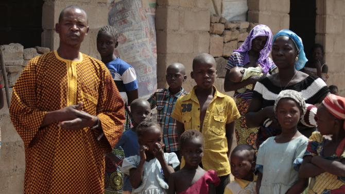 A family, that escaped Boko Haram attacks in both Michika and Cameroon, seek shelter in an uncompleted house in Adamawa
