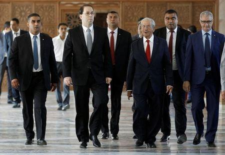 Tunisia's new government wins parliamentary approval, eyes austerity