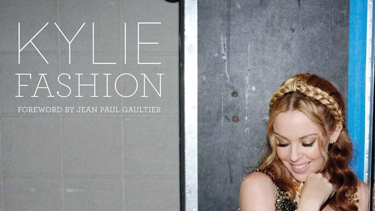 "In this book cover image released by Running Press, Australian recording artist Kylie Minogue appears on, ""Kylie Fashion,"" her new book that looks back at her fashion choices, particularly her stage costumes. (AP Photo/Running Press)"