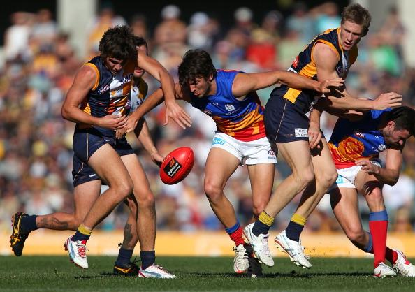 Rohan Bewick of the Lions contests for the ball against Andrew Gaff and Scott Selwood of the Eagles during the round 18 AFL match between the West Coast Eagles and the Brisbane Lions at Patersons Stadium on July 29, 2012 in Perth, Australia. (Photo by Paul Kane/Getty Images)