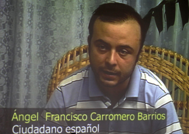 Spanish citizen Angel Francisco Carromero speaks during a press conference via pre-taped video footage that was shown during a press conference organized by Cuba's International Press Center, in Havana, Cuba, Monday, July 30, 2012. Carromero and Swedish citizen Jens Aron Modig, who were traveling with Cuban dissident Oswaldo Paya when he died in a car crash, are denying speculation that a second vehicle was involved. Carromero says he braked abruptly after entering an unpaved construction zone and lost control. (AP Photo/Franklin Reyes)