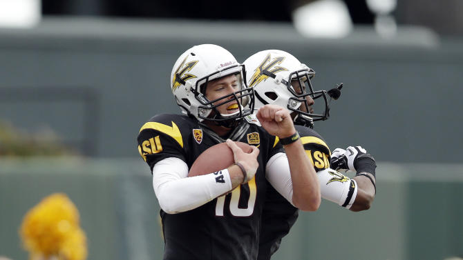 Arizona State quarterback Taylor Kelly (10) celebrates his 1-yard touchdown run with teammate Rashad Ross during the first half of the Fight Hunger Bowl NCAA college football game against Navy in San Francisco, Saturday, Dec. 29, 2012. (AP Photo/Marcio Jose Sanchez)