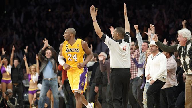 The crowd reacts after Los Angeles Lakers guard Kobe Bryant (24) shot a three-point basket to tie the score in regulation against the Toronto Raptors in the second half of an NBA basketball game in Los Angeles Friday, March 8, 2013. The Lakers won in overtime, 118-116. (AP Photo/Reed Saxon)