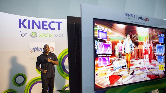 IMAGE DISTRIBUTED FOR XBOX - NFL running back Adrian Peterson makes an appearance playing Kinect for Xbox 360 with kids on Thursday, Jan. 31, 2013 in New Orleans. (Photo by Barry Brecheisen/Invision for Xbox/AP Images)