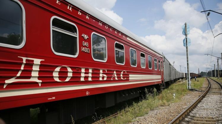 "A passenger carriage with the word ""Donbass"", part of the train carrying the remains of victims of Malaysia Airlines MH17 downed over rebel-held territory in eastern Ukraine, is pictured after it arrived in the city of Kharkiv"